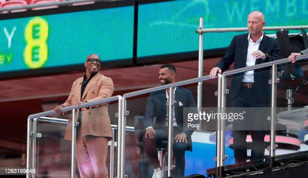 Ian Wright Ashley Cole and Alan Shearer are seen in the TV studio inside the stadium during the Heads Up FA Cup Final match between Arsenal and...