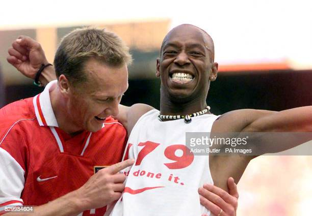 Ian Wright celebrates his equalising goal with Lee Dixon at Highbury against Bolton Wanderers this afternoon to equal the goalscoring record of...