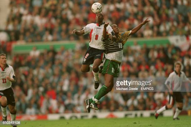 Ian Wright England {L} gets to the high ball before Doctor Khumalo South Africa {R}