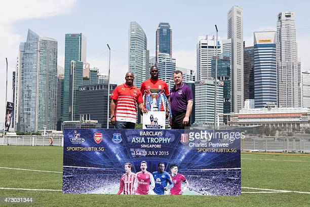 Ian Wright former Arsenal player Mamady Sidibe former Stoke player and Graham Stuart former Everton player pose with the Barclays Asia Trophy during...