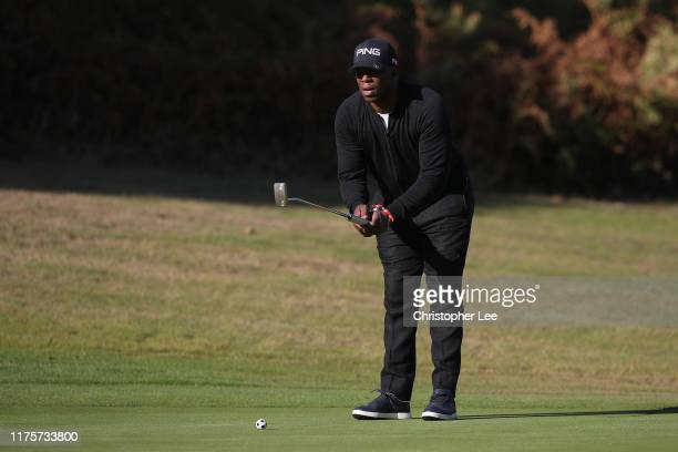Ian Wright lines up a putt during the PCA Trust Golf Day at Woburn Golf Club on September 19 2019 in Woburn England
