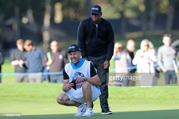 Ian Wright lines up a putt with his caddie during the BMW PGA Championship Pro Am at Wentworth Club Virginia Water on Wednesday 18th September 2019