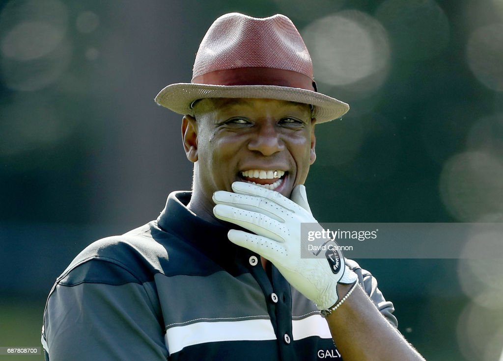 Ian Wright of England the former international footballer reacts to a shot during the pro-am for the 2017 BMW PGA Championship on the West Course at Wentworth on May 24, 2017 in Virginia Water, England.