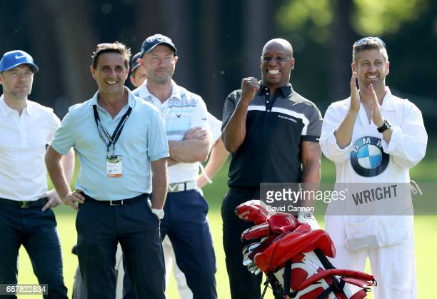 Ian Wright of England the former international footballer reacts to a shot with Alan Shearer and Ronan Keating during the proam for the 2017 BMW PGA...