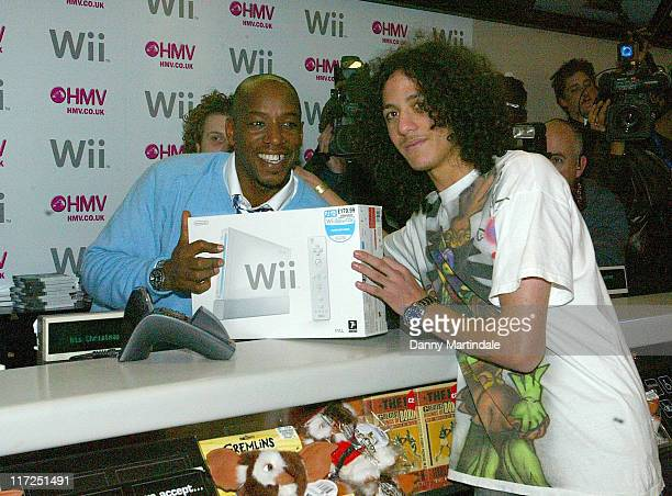 Ian Wright serves first customer with the Nintendo Wii