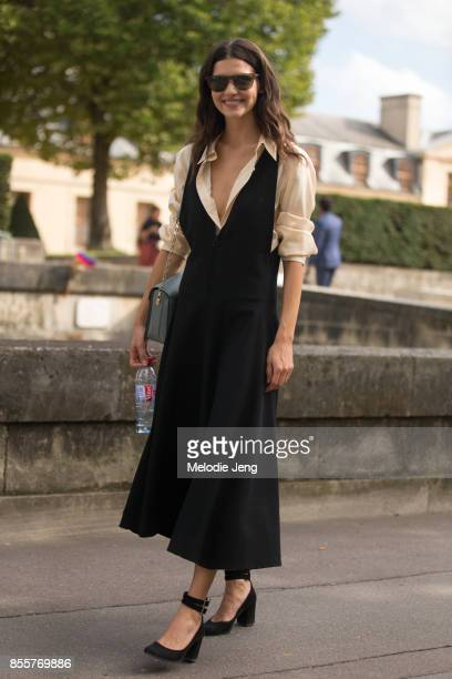 Iana Godnia wears a Lemaire dress and shirt and Balenciaga shoes on September 29, 2017 in Paris, France.