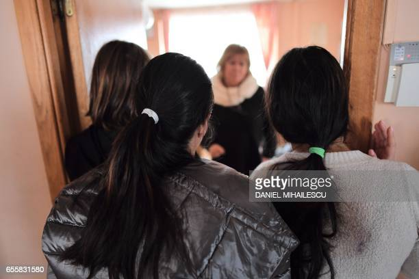 Iana Matei a Romanian psychologist who takes care of minors who have been victims of human trafficking talks with some of the girls there at the...