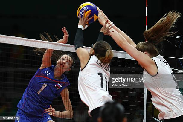 Iana Shcherban of Russia spikes the ball in front of Julieta Constanza Lazcano Colodrero of Argentina during the Women's Preliminary Pool A match...