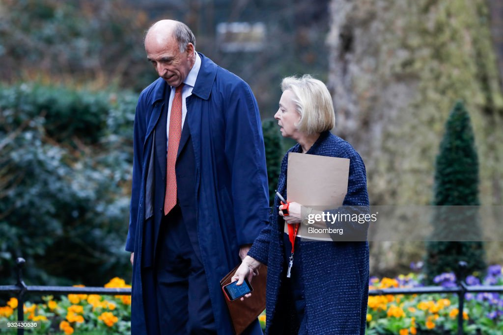 Ian Davis, chairman of Rolls-Royce Plc Pension Schemes, left, and Moya Greene, chief executive officer of Royal Mail Group Ltd., arrive for a meeting of the Business Advisory Council at Downing Street in London, U.K., on Thursday, March 15, 2018. U.K. Prime Minister Theresa May is due to meet business leaders on Thursday to discuss Britain's departure from the European Union. Photographer: Luke MacGregor/Bloomberg via Getty Images