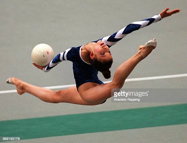 Ianina Batyrchina of Russia performs with the ball in the individual all–around semifinals of rhythmic gymnastics during today's competition
