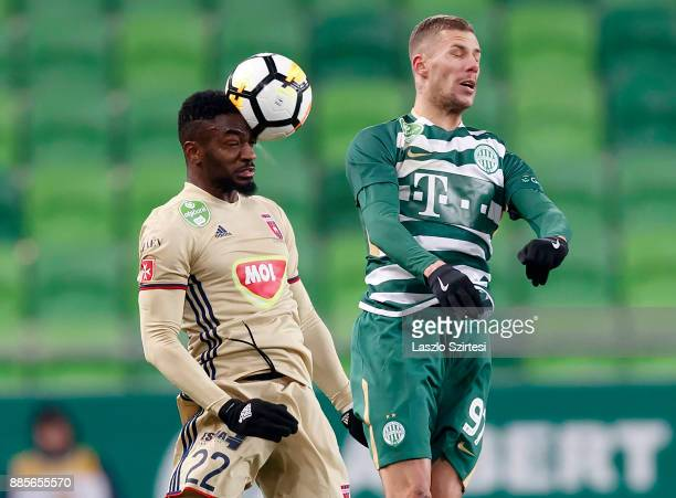 Ianique dos Santos Tavares 'Stopira' #22 of Videoton FC wins the ball in the air from Roland Varga of Ferencvarosi TC during the Hungarian OTP Bank...
