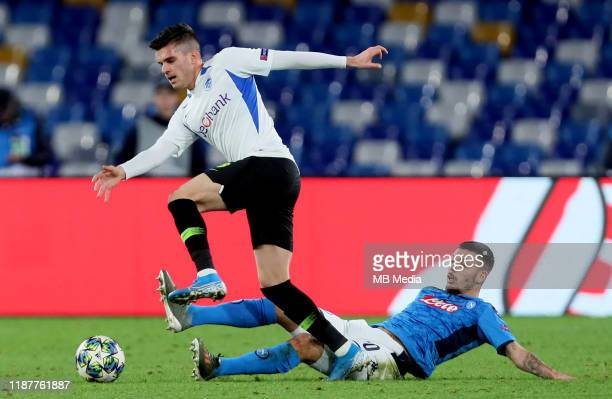 Ianis Hagi of KRC Genk competes for the ball with Gianluca Gaetano of SSC Napoli during the UEFA Champions League group E match between SSC Napoli...