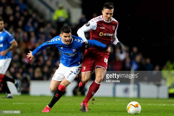 Ianis Hagi of Rangers and Joao Palhinha of Braga during the UEFA Europa League round of 32 first leg match between Rangers FC and Sporting Braga at...