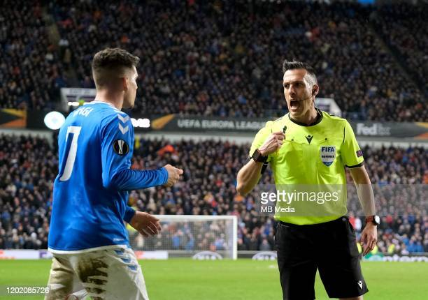 Ianis Hagi of Rangers and Referee Xavier Estrada Fernandez during the UEFA Europa League round of 32 first leg match between Rangers FC and Sporting...