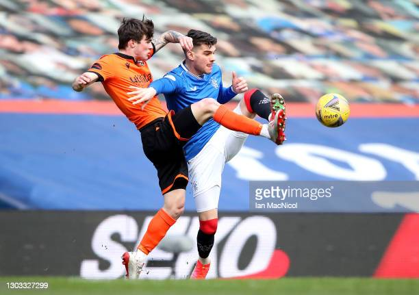 Ianis Hagi of Rangers battles for possession with Jamie Robson of Dundee United during the Ladbrokes Scottish Premiership match between Rangers and...