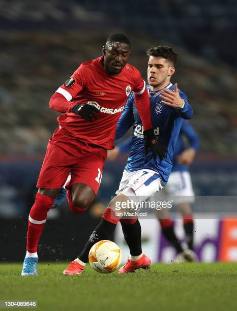Ianis Hagi of Rangers battles for possession with Martin Hongla of Royal Antwerp during the UEFA Europa League Round of 32 match between Rangers FC...