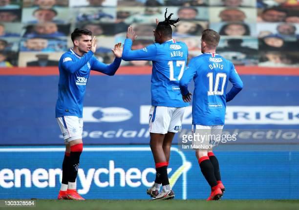 Ianis Hagi of Rangers celebrates with Joe Aribo and Steven Davis after scoring his team's first goal during the Ladbrokes Scottish Premiership match...
