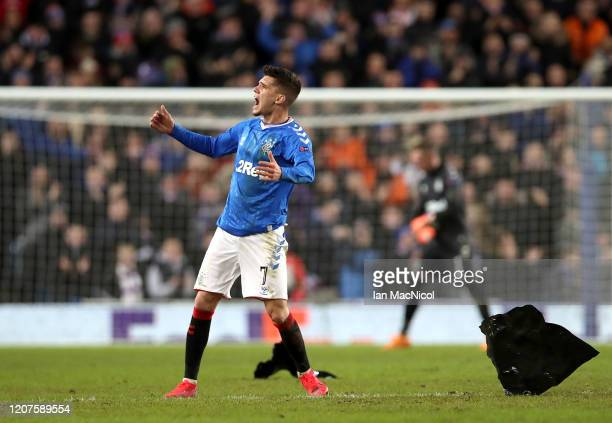 Ianis Hagi of Rangers FC celebrates scoring his sides first goal during the UEFA Europa League round of 32 first leg match between Rangers FC and...