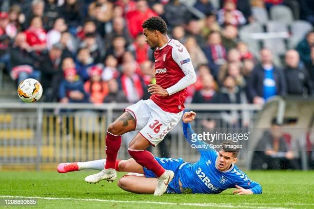 Ianis Hagi of Rangers FC competes for the ball with Bruno Viana of SC Braga during the UEFA Europa League round of 32 second leg match between...