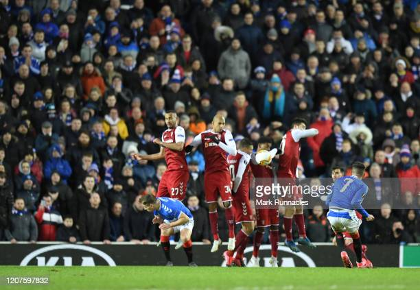 Ianis Hagi of Rangers FC scores his sides third goal during the UEFA Europa League round of 32 first leg match between Rangers FC and Sporting Braga...