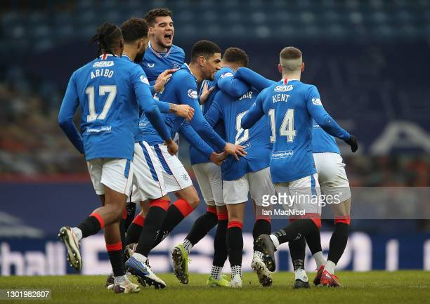 Ianis Hagi of Rangers is seen as team mate congratulate Ryan Jack of Rangers after scoring their side's first goal during the Ladbrokes Scottish...
