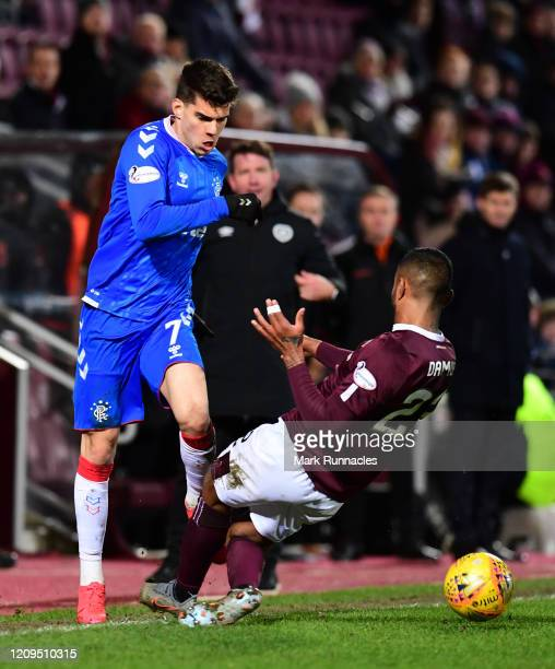 Ianis Hagi of Rangers is tackled by Loïc Damour of Hearts during the Scottish Cup Quarter Final match between Hearts and Rangers at Tynecastle Park...