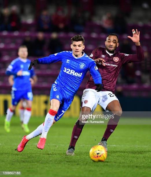 Ianis Hagi of Rangers looks to break past Loïc Damour of Hearts during the Scottish Cup Quarter Final match between Hearts and Rangers at Tynecastle...