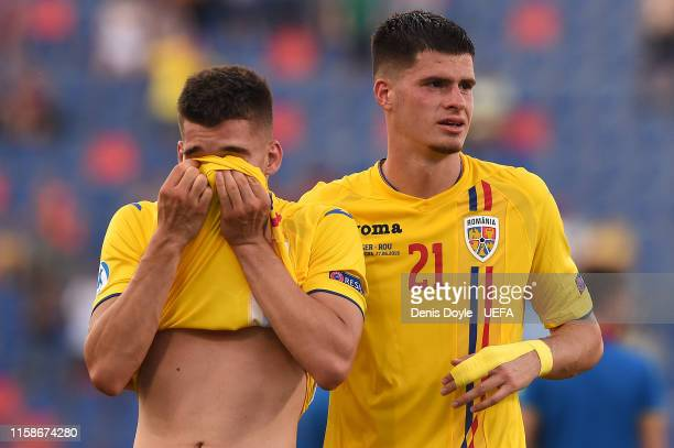 Ianis Hagi of Romania and Tudor Baluta of Romania show their dejection at the end of the 2019 UEFA U21 SemiFinal match between Germany and Romania at...