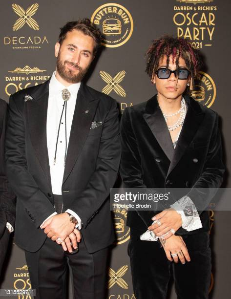 Iann Dior and Darren Dzienciol walk the red carpet at Darren Dzienciol & Richie Akiva's Oscar party 2021 on April 25, 2021 in Bel Air, California.