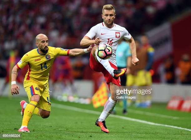 Iasmin Latovlevici of Romania and Jakub Blaszczykowski of Poland in action during the 2018 FIFA World Cup Russia eliminations match between Poland...