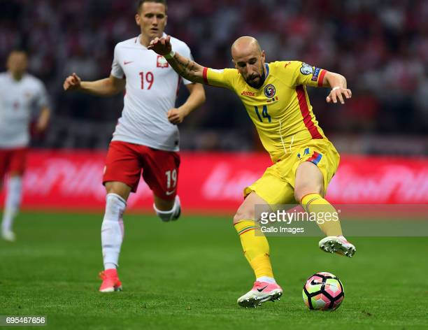 Iasmin Latovlevici of Romania and Piotr Zielinski of Poland in action during the 2018 FIFA World Cup Russia eliminations match between Poland and...