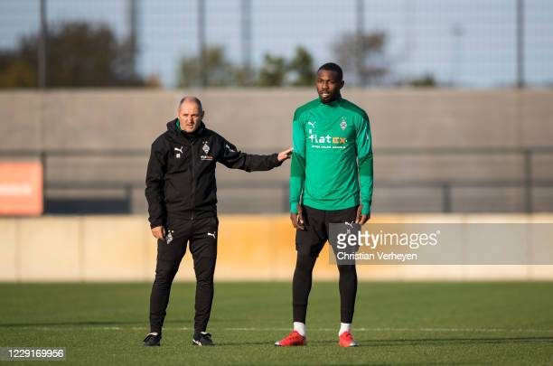 October 19: IAssistant Coach Oliver Neuville and Marcus Thuram of Borussia Moenchengladbach are seen during a training session of Borussia...