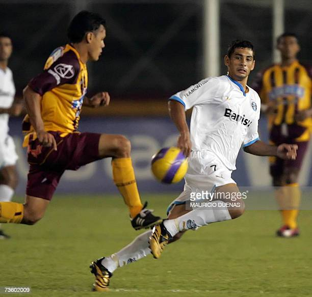 Diego Souza of Brazil's Gremio vies for the ball with Hernando Patino of Colombia's Deportes Tolima during a Libertadores Cup football match 15 March...