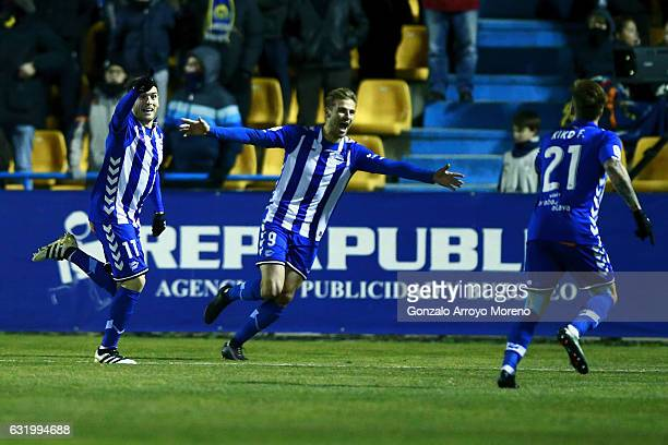 Ibai Gomez of Deportivo Alaves celebrates scoring their opening goal with teammates Christian Santos and Kiko Femenia during the Copa del Rey...