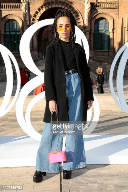 Ibaiz Liebana wears Bershka sunglasses Uterque coat Mango shoes a handbag from a Vintage market Pull Bear black sweater and jeans during the 080...