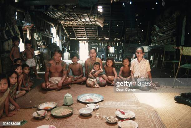 Iban Family at Mealtime in Their Longhouse Apartment