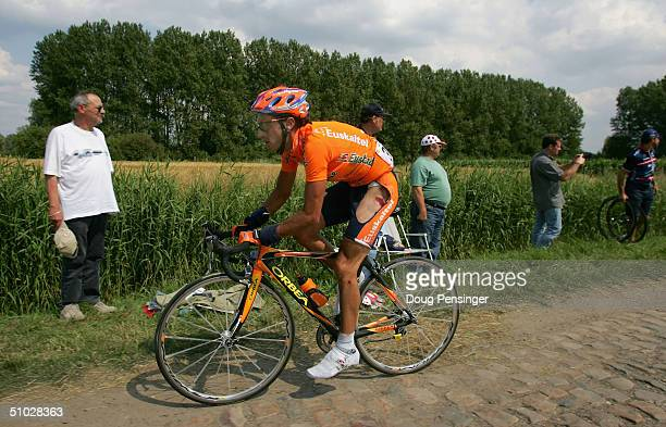 Iban Mayo of Spain and riding for Euskatel Euskadi shows evidence of an earlier crash as he makes his way through the first section of pave during...