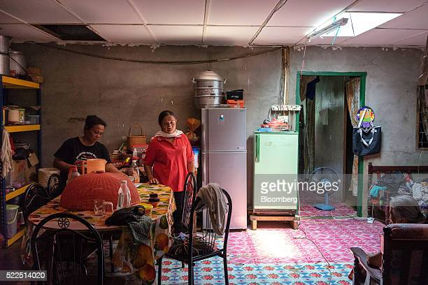 Iban women work inside a modern longhouse in the village of Lebor near Serian Sarawak Malaysia on Thursday April 14 2016 Indifference to the scandals...