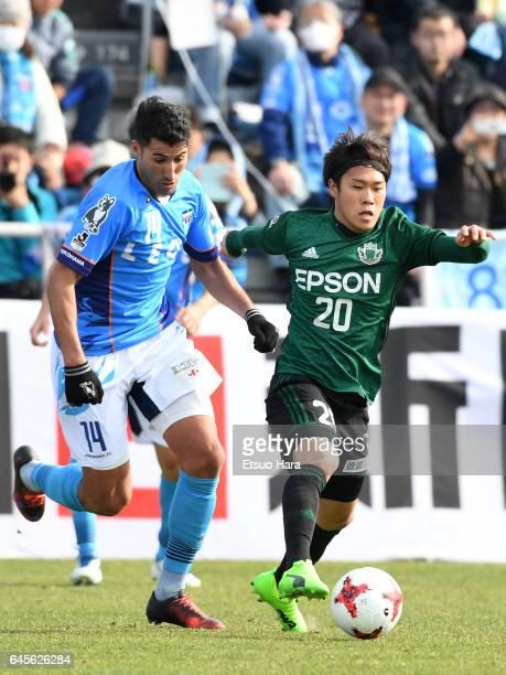 Ibba of Yokohama FC and Takayoshi Ishihara of Matsumoto Yamaga compete for the ball during the JLeague J2 match between Yokohama FC and Matsumoto...