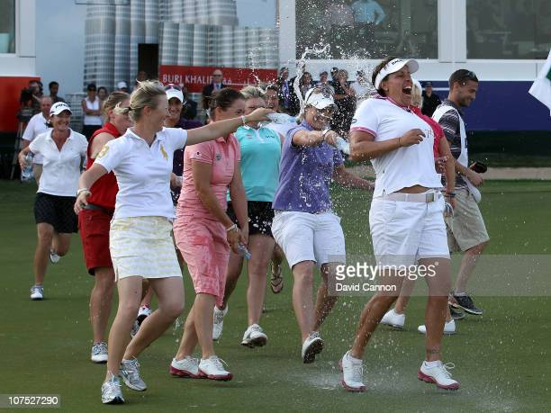 Iben Tinning of Denmark is chased accross the final green by fellow players after holing the winning putt in her final tournament before retirement...