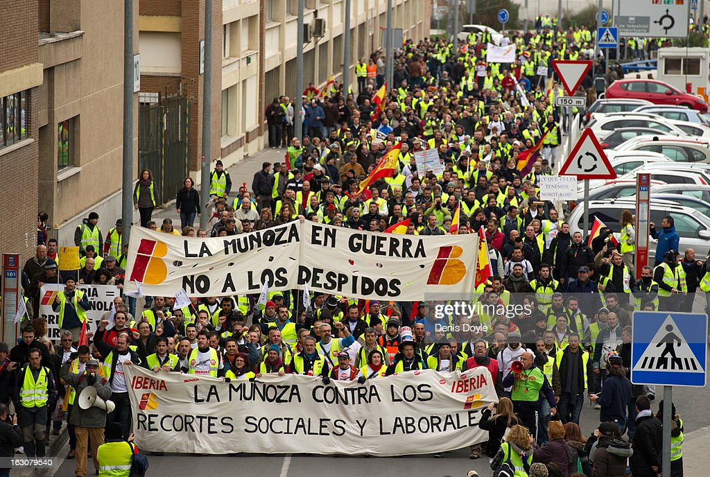 Iberia workers march towards Barajas airport during a strike on March 4, 2013 in Madrid, Spain. Iberia workers have begun the second round of five day strikes in protest at plans by holding company IAG (International Consolidated Airlines Group), formed by the 2011 merger of Iberia and British Airways, to implement redundancies and pay cuts across the troubled Spanish airline. The strike is estimated to cause the cancelling almost 1,300 flights this week, with a final round of five day strikes planned for March 18 to 22.