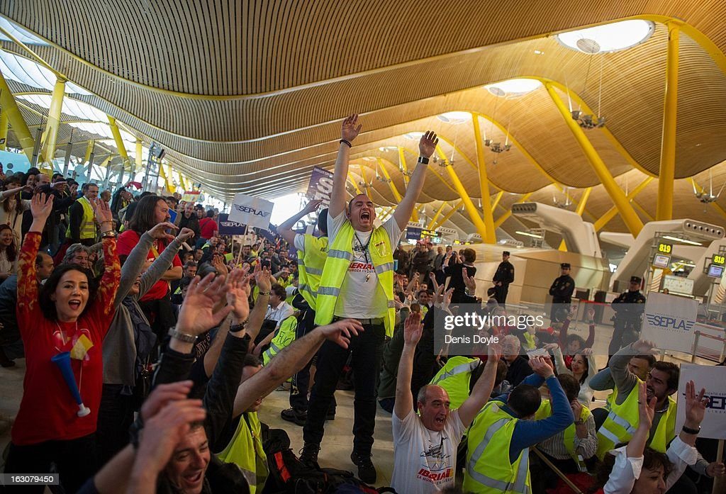 Iberia workers protest at Barajas airport on March 4, 2013 in Madrid, Spain. Iberia workers have begun the second round of five day strikes in protest at plans by holding company IAG (International Consolidated Airlines Group), formed by the 2011 merger of Iberia and British Airways, to implement redundancies and pay cuts across the troubled Spanish airline. The strike is estimated to cause the cancelling almost 1,300 flights this week, with a final round of five day strikes planned for March 18 to 22.