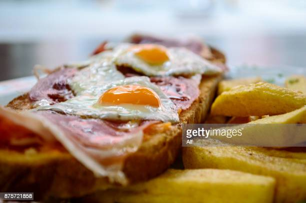 Iberian ham toast with eggs and chips