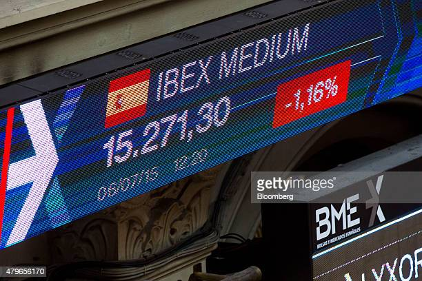 Ibex 35 stock price information is displayed on electronic screens inside the Madrid Stock Exchange also known as Bolsa y Mercado in Madrid Spain on...