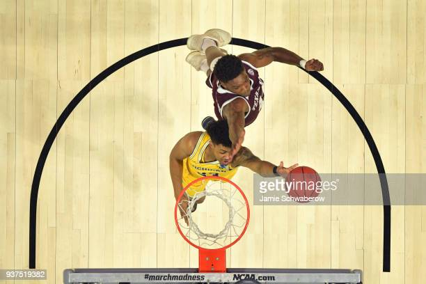 Ibi Watson of the Michigan Wolverines goes up for the shot against Robert Williams of the Texas A&M Aggies during the third round of the 2018 NCAA...