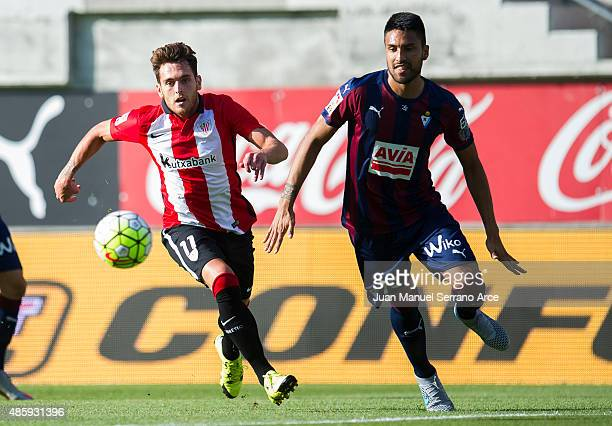 Ibia Gomez of Athletic Club duels for the ball with Mauro Javier Dos Santos of SD Eibar during the La Liga match between SD Eibar and Athletic Club...