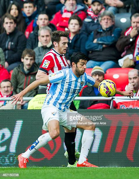 Ibia Gomez of Athletic Club duels for the ball withÊMiguel Torres of Malaga CF during the La Liga match between Athletic Club and Malaga CF at San...