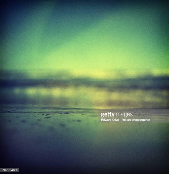 Ibiza sea with green sky surrealist sky