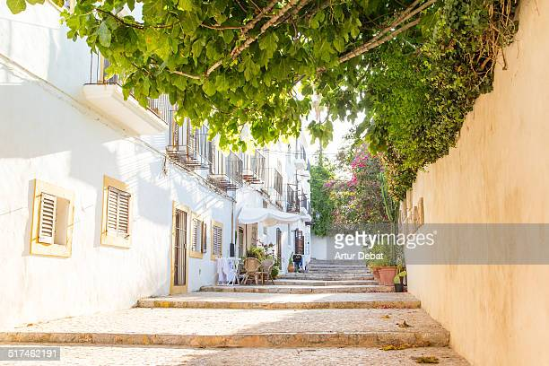 Ibiza town stairs street with low light sunset.