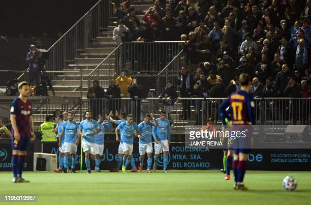 Ibiza's players celebrates a goal scored by Ibiza's Spanish midfielder Josep Caballe during the Copa del Rey football match between UD Ibiza and FC...